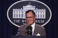 ***FILE PHOTO*** George H.W. Bush Has Passed Away<br /> Washington, DC. 1990<br /> President George H. W. Bush  stands at the podium as he responds to reporters questions during a news conference in the press briefing room at the White House.<br /> CAP/MPI/MRN<br /> &copy;MRN/MPI/Capital Pictures