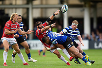 James Hanson of Gloucester Rugby offloads the ball after being tackled by Joe Cokanasiga of Bath Rugby. Gallagher Premiership match, between Bath Rugby and Gloucester Rugby on September 8, 2018 at the Recreation Ground in Bath, England. Photo by: Patrick Khachfe / Onside Images