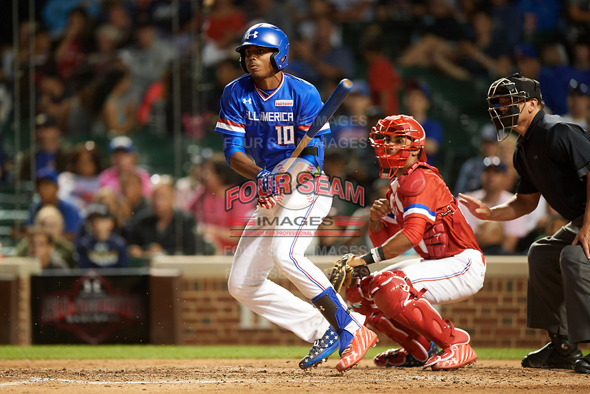 Joe Gray (10) of Hattiesburg High School in Hattiesburg, Mississippi at bat in front of catcher Kameron Ojeda (27) of St. John Bosco High School in La Mirada, California during the Under Armour All-American Game presented by Baseball Factory on July 29, 2017 at Wrigley Field in Chicago, Illinois.  (Mike Janes/Four Seam Images)