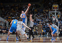 Travis Wear of UCLA tips off against California during the game at Haas Pavilion in Berkeley, California on February 19th, 2014.  UCLA defeated California, 86-66.