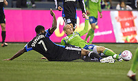 Osvaldo Alonso, right, of the Seattle Sounders FC and Khari Stephenson slide for the ball during play between at CenturyLink Field in Seattle Saturday October 15, 2011. The Sounders FC won the game 2-1.