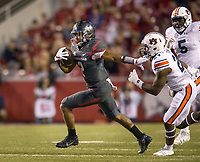 Hawgs Illustrated/BEN GOFF <br /> Chase Hayden, Arkansas running back, evades Daniel Thomas, Auburn nickel back, after a catch for 23 yards in the first quarter Saturday, Oct. 21, 2017, at Reynolds Razorbacks Stadium in Fayetteville.