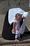 A Druze woman attends her daughter as women wait at Quneitra border-crossing in Israel-Syria border, upon the return of Druze students from their studies at Damascus University in Syria.