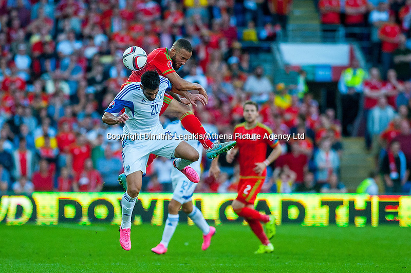 (L-R )Omri Ben Harush of Isreal  and Ashey Richards of Wales jump for the ball during their UEFA EURO 2016 Group B qualifying round match held at Cardiff City Stadium, Cardiff, Wales, 06 September 2015. EPA/DIMITRIS LEGAKIS