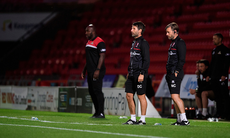 Doncaster Rovers manager Darren Moore, left, Lincoln City manager Danny Cowley, centre, and Lincoln City's assistant manager Nicky Cowley<br /> <br /> Photographer Chris Vaughan/CameraSport<br /> <br /> EFL Leasing.com Trophy - Northern Section - Group H - Doncaster Rovers v Lincoln City - Tuesday 3rd September 2019 - Keepmoat Stadium - Doncaster<br />  <br /> World Copyright © 2018 CameraSport. All rights reserved. 43 Linden Ave. Countesthorpe. Leicester. England. LE8 5PG - Tel: +44 (0) 116 277 4147 - admin@camerasport.com - www.camerasport.com