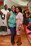 Nana Eyeson-Akiwowo (left), posing with guest during the African Health Now - Fashion Fete event, at the Tracy Reese store on 641 Hudson Street, June 20, 2013.