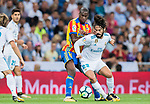 Geoffrey Kondogbia (l) of Valencia CF battles for the ball with Isco Alarcon of Real Madrid during their La Liga 2017-18 match between Real Madrid and Valencia CF at the Estadio Santiago Bernabeu on 27 August 2017 in Madrid, Spain. Photo by Diego Gonzalez / Power Sport Images((