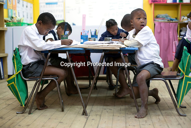 CAPE TOWN, SOUTH AFRICA - NOVEMBER 27:  School children study at a farm school on November 27, 2015 outside Cape Town, South Africa. Some of the children have FAS, Fetal Alcohol Syndrome, where the mother drank a lot of alcohol during pregnancy. Many wine workers in South Africa had part of their salary paid in wine. (Photo by: Per-Anders Pettersson)