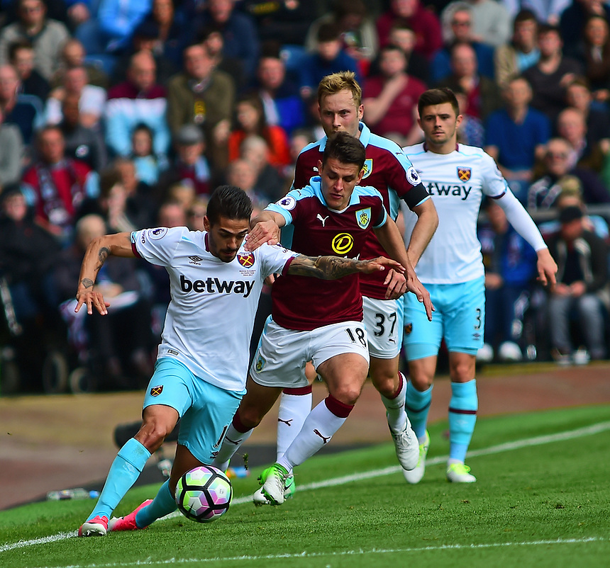West Ham United's Manuel Lanzini shields the ball from Burnley's Ashley Westwood<br /> <br /> Photographer Andrew Vaughan/CameraSport<br /> <br /> The Premier League - Burnley v West Ham United - Sunday 21st May 2017 - Turf Moor - Burnley<br /> <br /> World Copyright &copy; 2017 CameraSport. All rights reserved. 43 Linden Ave. Countesthorpe. Leicester. England. LE8 5PG - Tel: +44 (0) 116 277 4147 - admin@camerasport.com - www.camerasport.com