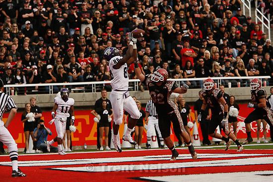 Trent Nelson  |  The Salt Lake Tribune.TCU's Jimmy Young pulls down a touchdown pass ahead of Utah defender Chaz Walker during the second half, Utah vs. TCU college football, Saturday, November 6, 2010. TCU won 47-7.