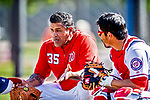 21 February 2019: Washington Nationals Bullpen Coach Henry Blanco chats with catcher Kurt Suzuki during a Spring Training workout at the Ballpark of the Palm Beaches in West Palm Beach, Florida. Mandatory Credit: Ed Wolfstein Photo *** RAW (NEF) Image File Available ***