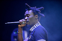 CORAL GABLES, FL - AUGUST 10: John Wicks performs on stage at Kodak Black Homecoming Concert first show since getting home from jail in June at Watsco Center on August 10, 2017 in Coral Gables, Florida.  Credit: MPI10 / MediaPunch