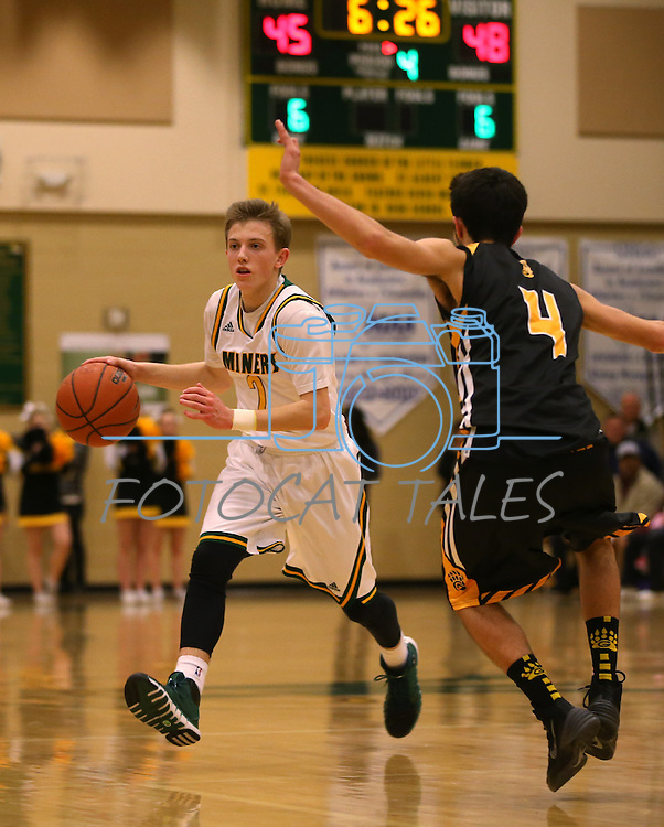 Manogue's Collin Bernard and Galena's Noah Peck compete at Manogue High School in Reno, Nev., on Tuesday, Feb. 11, 2014. Manogue won 66-59.<br /> Photo by Cathleen Allison