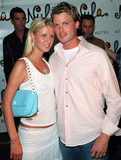 Nikki Hilton (Nicky Hilton) and boyfriend Bryan McFayden arrive at the opening of Britney Spears' restaurant Nyla at New York's Dylan Hotel. June 27, 2002. Catolic church is frowning on come celebrities who use cross as a hot accessory. Perhaps Nikki decided to challenge that by wearing both, the cross pendant and cross earrings.  Please byline: Alecsey Boldeskul/NY Photo Press.   ..*PAY-PER-USE*      ....NY Photo Press:  ..phone (646) 267-6913;   ..e-mail: info@nyphotopress.com