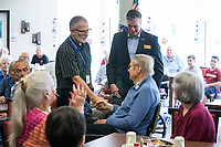 NWA Democrat-Gazette/BEN GOFF @NWABENGOFF<br /> David 'Doc' Kenser (from left), veteran services coordinator with Arkansas Hospice and a vietnam era U.S. Air Force veteran, and Cpl. Aaron Mankin, a U.S. Marine Corps Iraq veteran, recognize Dick Pudas, who served in the U.S. Army from 1954-56, Tuesday, June 4, 2019, during a pinning ceremony for military veterans at Primrose Retirement Communities Assisted Living in Rogers. The program recognized 32 local veterans, most of whom are residents of the facility.. The recognition is part of Arkansas Hospice's We Honor Veterans campaign to pay respect to veterans in their later years. Mankin, who works with congressman Steve Womack's office, also shared his story of surviving a bomb blast in Iraq in 2015.