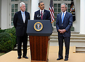 U.S. President Barack Obama (C) makes remarks as former Presidents Bill Clinton (L) and George W. Bush listen after their meeting in the Oval Office, in the  aftermath of the devastating earthquake in Haiti, at the White House in Washington, DC, USA, USA 16 January 2010.  Obama discussed enlisting the help of the American people to help in the recovery and rebuilding of Haiti.  .Credit: Mike Theiler / Pool via CNP