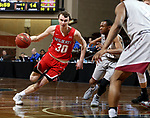 SIOUX FALLS, SD - MARCH 12:  Grant Smith #30 from Indiana Wesleyan drives against Jaylen McKay #11 from IU East during their semifinal game at the 2018 NAIA DII Men's Basketball Championship at the Sanford Pentagon in Sioux Falls. (Photo by Dave Eggen/Inertia)