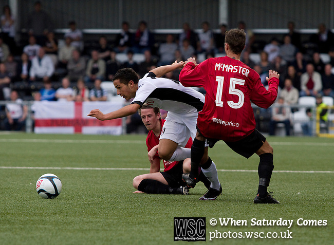 Crusaders 1 Fulham 3, 16/07/2011. Seaview Park, Europa League 2nd qualifying round first leg. Fulham midfielder Kerim Frei (white shirt) is tackled by two Crusaders players during the first half of a UEFA Europa League 2nd qualifying round, first leg match at Seaview, Belfast. The visitors from England won by 3 goals to 1 before a crowd of 3011. Photo by Colin McPherson.