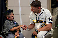 Michigan Wolverines head coach Erik Bakich shakes the hand of Matt Medina from Houston after the NCAA College World Series Finals press conference on June 23, 2019 at TD Ameritrade Park in Omaha, Nebraska. Michigan will play Vanderbilt in the CWS Finals. (Andrew Woolley/Four Seam Images)