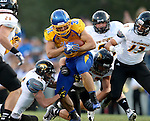 BROOKINGS, SD - SEPTEMBER 20:  Zach Zenner #31 from South Dakota State bowls over the defense from Wisconsin-Oshkosh in the first half of their game Saturday at Coughlin Alumni Stadium in Brookings. (Photo/Dave Eggen/Inertia)