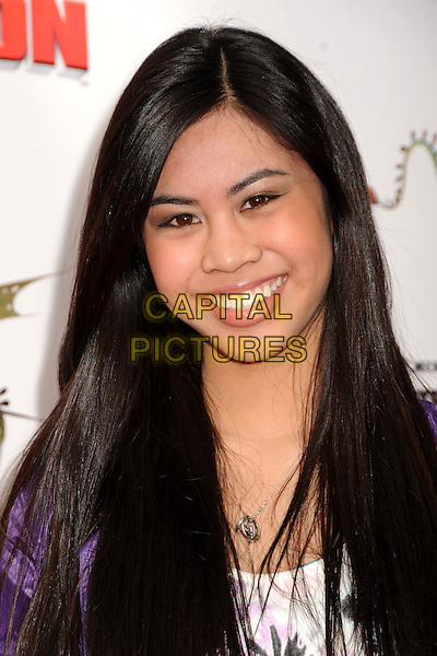 "ASHLEY ARGOTA .""How To Train Your Dragon"" Los Angeles Premiere held at the Gibson Amphitheatre, Universal City, California, USA, 21st March 2010..arrivals portrait headshot  purple smiling .CAP/ADM/BP.©Byron Purvis/AdMedia/Capital Pictures."