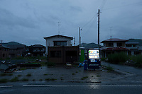 Landscape view of a vending machine and damaged buildings following the 311 Tohoku Tsunami in Ishinomaki, Japan  © LAN