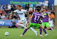 Joe Rodon of Swansea City vies for possession with Callum O'Dowda of Bristol City during the Sky Bet Championship match between Swansea City and Bristol City at the Liberty Stadium, Swansea, Wales, UK. Saturday 25 August 2018