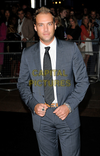 CALUM BEST .Attending the Ozwald Boateng Fashion Show during the final day of London Fashion Week, Odeon cinema Leicester Square London, England, UK,.September 22nd 2010..half length cross ring hand brown belt  tie black white grey gray suit .CAP/CAN.©Can Nguyen/Capital Pictures.