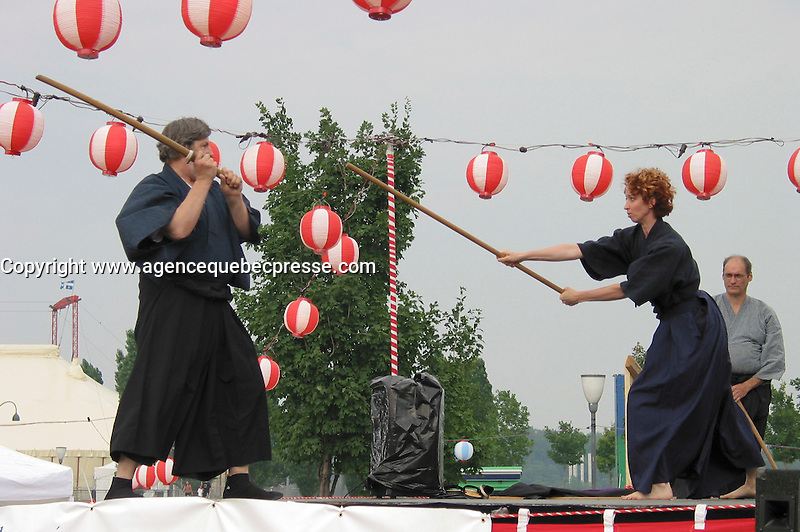 July 6  2002, Montreal, Quebec, Canada<br /> <br /> Display of traditional Japanese  fighting  during the Matsuri one day Japanese Festival in Montreal Old Port, Juy 6 2002.<br /> <br /> The event feature demonstration of Japanese traditional martial art, music, food and other activities.<br /> <br /> <br /> <br /> Mandatory Credit: Photo by Pierre Roussel- Images Distribution. (&copy;) Copyright 2002 by Pierre Roussel <br /> <br /> NOTE :<br /> Canon G-2 oroginal jpeg, converted from sRG to  Adobe 1998 RGB.<br /> Original size and uncompressed file available on request.
