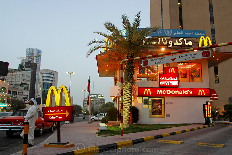 A drive-through McDonald's restaurant in downtown Kuwait City, Kuwait. The affluent Kuwaiti capital is peppered with U.S. fast-food chains and franchised restaurants. (Supporting image from the project Hungry Planet: What the World Eats.)