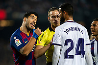 29th October 2019; Camp Nou, Barcelona, Catalonia, Spain; La Liga Football, Barcelona versus Real Valladolid; Luis Suarez of FC Barcelona makes a point about a tackle with Joaquin of Valladolid as the referee steps in