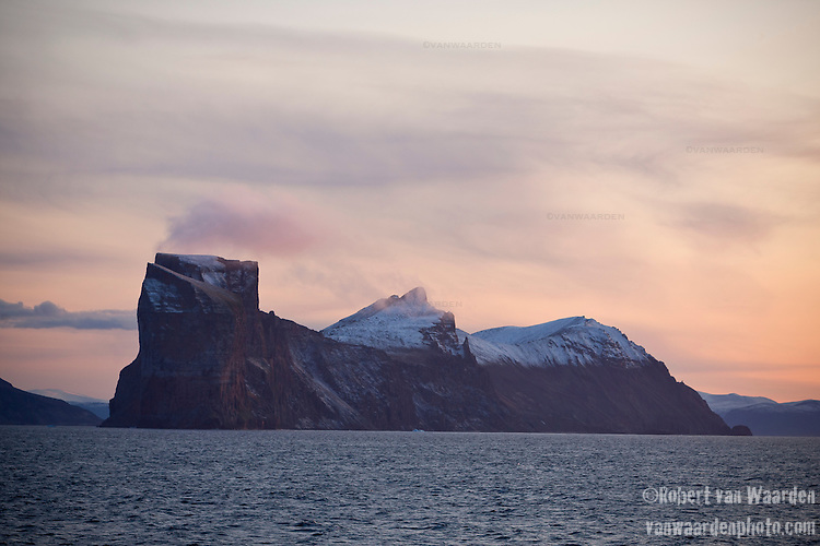 The sunsets on the rocky mountains of the East Coast of Baffin Island, Canada.