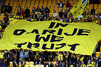 "Yellow Fever fans display a banner stating ""In Darije We Trust"" during the A-League football match between Wellington Phoenix and Adelaide United FC at Westpac Stadium in Wellington, New Zealand on Sunday, 8 October 2017. Photo: Mike Moran / lintottphoto.co.nz"
