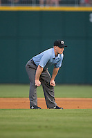 First base umpire Ian Fazio during the International League game between the Norfolk Tides and the Charlotte Knights at BB&T BallPark on April 9, 2015 in Charlotte, North Carolina.  The Knights defeated the Tides 6-3.   (Brian Westerholt/Four Seam Images)