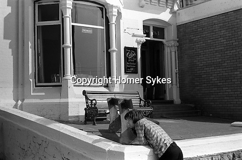 Outside a Bed and Breakfast hotel, Blackpool, Lancashire. England.  1974