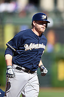 Milwaukee Brewers third baseman Mark Reynolds (7) runs the bases after hitting a home run during a game against the Chicago Cubs on August 14, 2014 at Wrigley Field in Chicago, Illinois.  Milwaukee defeated Chicago 6-2.  (Mike Janes/Four Seam Images)