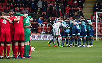 Pre match team huddles ahead of the Sky Bet League 2 match between Leyton Orient and Wycombe Wanderers at the Matchroom Stadium, London, England on 1 April 2017. Photo by Andy Rowland.