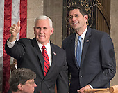 United States Vice President Mike Pence, left, and Speaker of the US House of Representatives Paul Ryan (Republican of Wisconsin), right, gesture towards guests in the Speaker's gallery prior to the arrival of US President Donald J. Trump who will deliver his first State of the Union address to a joint session of the US Congress in the US House chamber in the US Capitol in Washington, DC on Tuesday, January 30, 2018.<br /> Credit: Ron Sachs / CNP