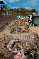 Group of tourists in Phuquoc museum Coconut Prison, Vietnam