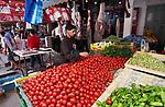A Palestinian vendor sells vegetables at a market during the holy month of Ramadan, on May 24, 2018. Ramadan is sacred to Muslims because it is during that month that tradition says the Koran was revealed to the Prophet Mohammed. The fast is one of the five main religious obligations under Islam. Muslims around the world will mark the month, during which believers abstain from eating, drinking, smoking and having sex from dawn until sunset. Photo by Mahmoud Ajour