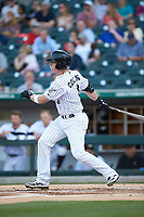 Zack Collins (8) of the Charlotte Knights follows through on his swing against the Toledo Mud Hens at BB&T BallPark on April 23, 2019 in Charlotte, North Carolina. The Knights defeated the Mud Hens 11-9 in 10 innings. (Brian Westerholt/Four Seam Images)