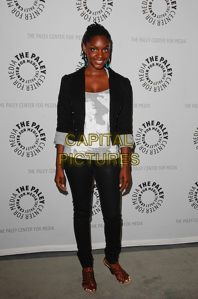 "YAANI KING .arriving at the Third Season Premiere and Panel Discussion for ""Saving Grace"" at The Paley Center for Media in Beverly Hills, California, USA, June 13th 2009..full length black blazer jacket sleeves rolled up trousers white print top skinny jeans brown sandals .CAP/ROT.©Lee Roth/Roth Stock/Capital Pictures."