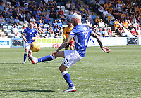 A bandaged Scott Mercer clears in the SPFL Betfred League Cup group match between Queen of the South and Motherwell at Palmerston Park, Dumfries on 13.7.19.