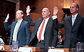 """Lamar McKay , President and Chairman , BP America, Inc., left,.Steven Newman , President and Chief Executive Officer, Transocean Limited, center, and Tim Probert , President, Global Business Lines; Chief Health, Safety and Environmental Officer, Halliburton, right, are sworn-in to testify during the United States Senate Committee on Environment and Public Works hearing entitled """"Economic and Environmental Impacts of the Recent Oil Spill in the Gulf of Mexico""""  in Washington, D.C. on Tuesday, May 11, 2010..Credit: Ron Sachs / CNP"""