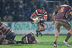 Samisoni Fisilau jumps over Nic Barrett as he runs from a ruck. ITM Cup Round 4 and Ranfurly Shield rugby game between Counties Manukau Steelers and Southland, played at Rugby Park Invercargill, on Friday July 29th 2011..Southland won the game 22 - 14 after leading 13 - 6 at halftime.