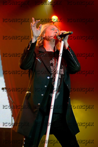 Def Leppard - vocalist Joe Elliott - performing live at the Wembley Arena in London UK -  26 June 2008.  Photo credit: George Chin/IconicPix