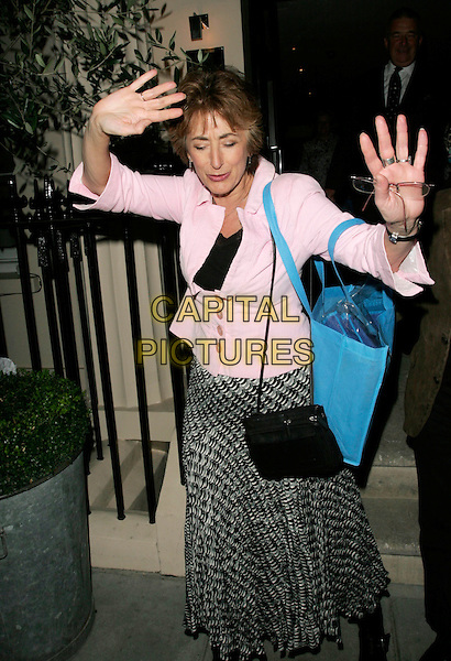 "MAUREEN LIPMAN .Attending Kathy Lette's ""To Love, Honour and Betray"" book launch party, London, England, September 24th 2008..half length pink jacket print skirt black bag boots hands funny dancing pose eyes shut .CAP/AH.©Adam Houghton/Capital Pictures"