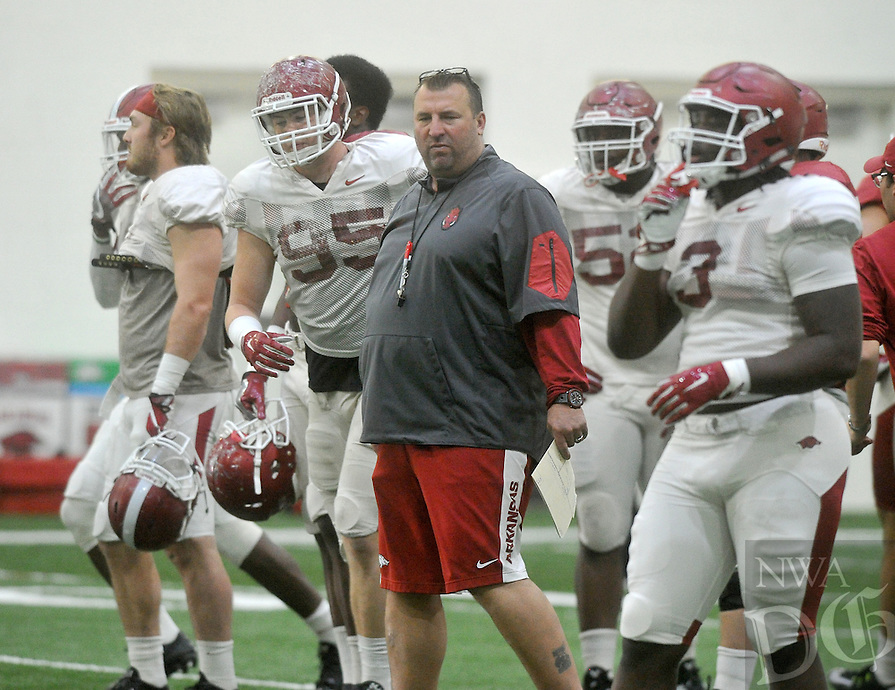 NWA Democrat-Gazette/MICHAEL WOODS &bull; @NWAMICHAELW<br /> University of Arkansas coach Bret Bielema watches his team practice Tuesday, April 5, 2016 in Fayetteville.