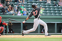 Outfielder Lewis Brinson (27) of the Hickory Crawdads bats in a game against the Greenville Drive on Sunday, June 9, 2013, at Fluor Field at the West End in Greenville, South Carolina. Brinson is the No. 12 prospect of the Texas Rangers, according to Baseball America and was a first-round pick (29th overall) in the 2012 First-Year Player Draft. Hickory won, 6-3. (Tom Priddy/Four Seam Images)