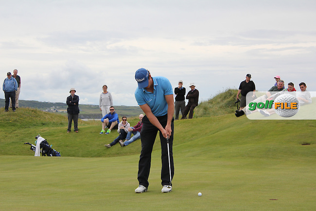 Colin Fairweather (Knock) on the 1st green during Matchplay Round 4 of the South of Ireland Amateur Open Championship at LaHinch Golf Club on Saturday 25th July 2015.<br /> Picture:  Golffile | TJ Caffrey